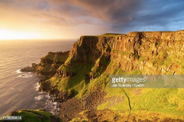 scenic view of sea against sky during sunset - belfast stock pictures, royalty-free photos & images