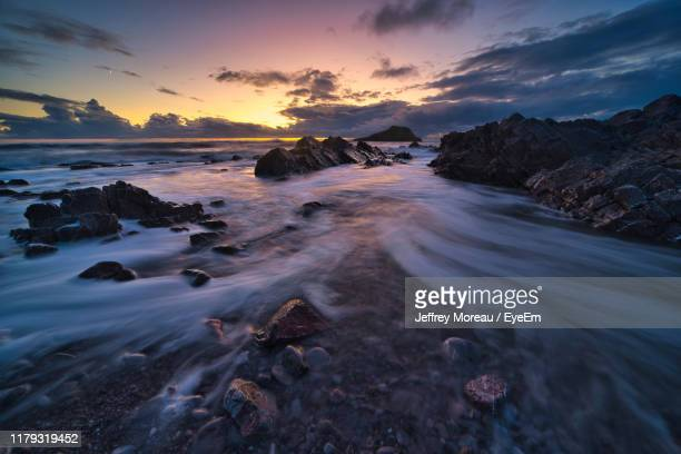 scenic view of sea against sky during sunset - glamorgan stock pictures, royalty-free photos & images
