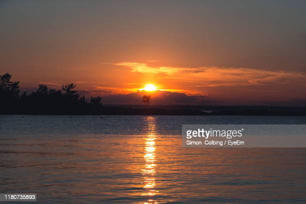 scenic view of sea against sky during sunset - colbing stock pictures, royalty-free photos & images