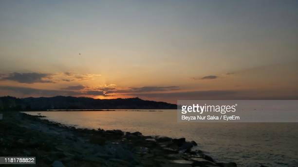 scenic view of sea against sky during sunset - saka stock pictures, royalty-free photos & images