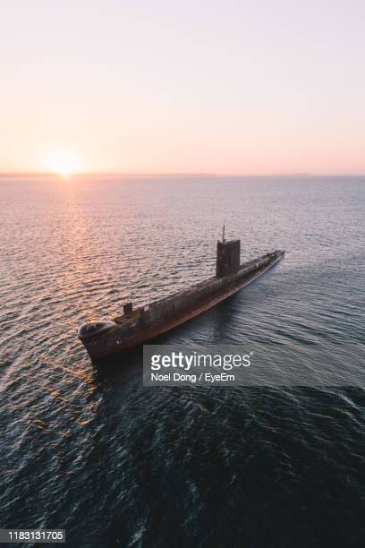scenic view of sea against sky during sunset - submarine stock pictures, royalty-free photos & images
