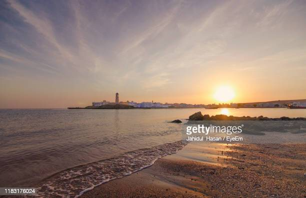 scenic view of sea against sky during sunset - oman stock pictures, royalty-free photos & images