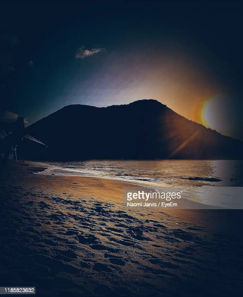 scenic view of sea against sky during sunset - naomi jarvis stock pictures, royalty-free photos & images