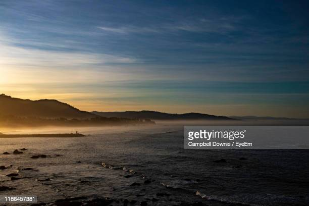 scenic view of sea against sky during sunset - campbell downie stock pictures, royalty-free photos & images
