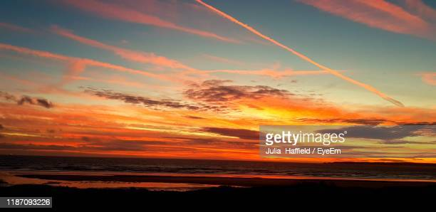scenic view of sea against sky during sunset - port talbot stock pictures, royalty-free photos & images
