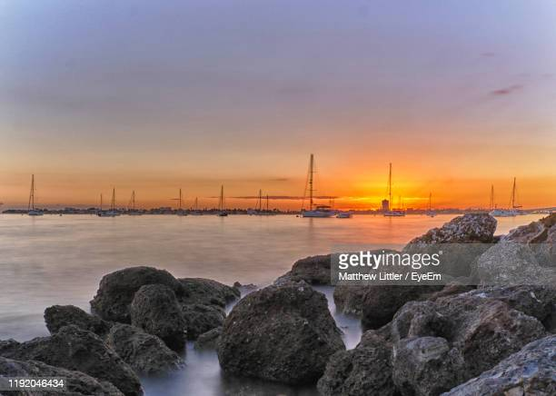 scenic view of sea against sky during sunset - sarasota stock pictures, royalty-free photos & images