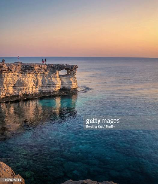 scenic view of sea against sky during sunset - repubiek cyprus stockfoto's en -beelden