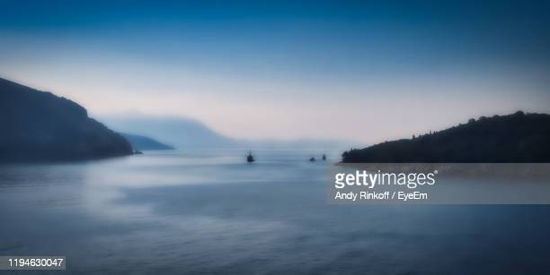 scenic view of sea against sky during sunset - andy rinkoff stock pictures, royalty-free photos & images