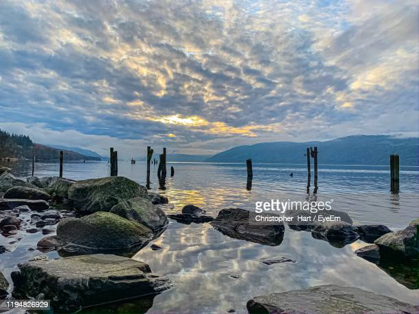 scenic view of sea against sky during sunset - loch ness monster stock pictures, royalty-free photos & images