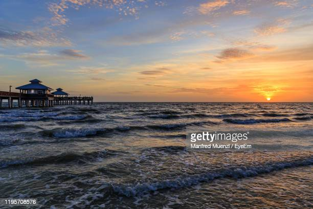scenic view of sea against sky during sunset - fort myers beach stock-fotos und bilder
