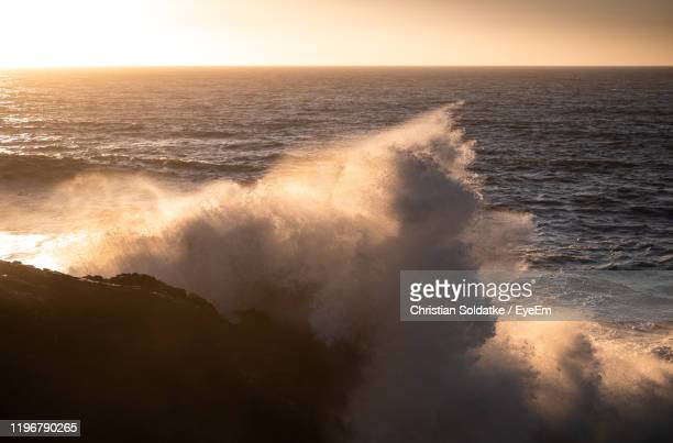 scenic view of sea against sky during sunset - christian soldatke stock pictures, royalty-free photos & images