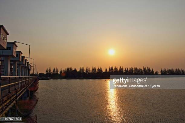 scenic view of sea against sky during sunset - panaikorn chutidaralux stock photos and pictures
