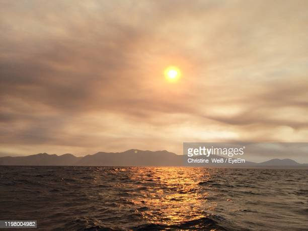 scenic view of sea against sky during sunset - weiß stock pictures, royalty-free photos & images