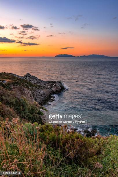 scenic view of sea against sky during sunset - flowing cape stock pictures, royalty-free photos & images