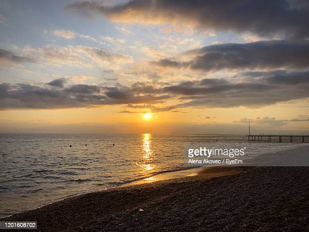 scenic view of sea against sky during sunset - belek stock pictures, royalty-free photos & images