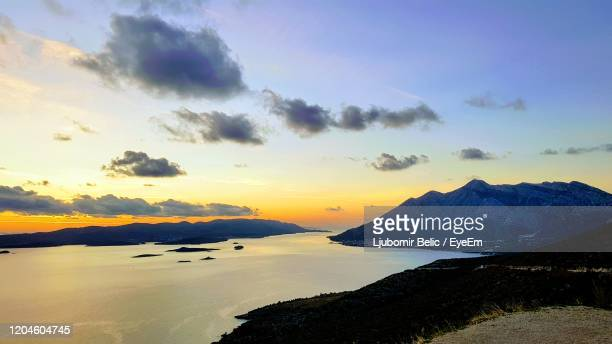 scenic view of sea against sky during sunset - ljubomir belic stock pictures, royalty-free photos & images
