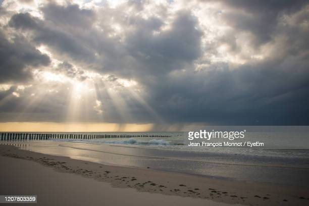 scenic view of sea against sky during sunset - rainy season stock pictures, royalty-free photos & images