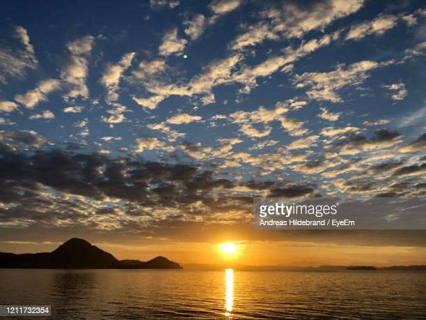 scenic view of sea against sky during sunset - andreas solar stock pictures, royalty-free photos & images