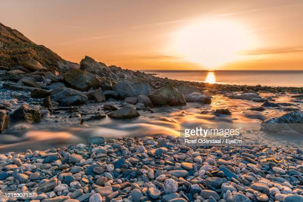 scenic view of sea against sky during sunset - isle of man stock pictures, royalty-free photos & images
