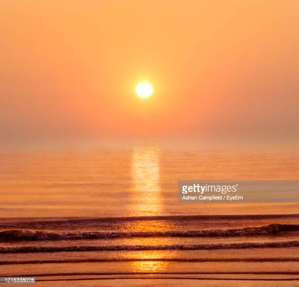 scenic view of sea against sky during sunset - golden hour stock pictures, royalty-free photos & images