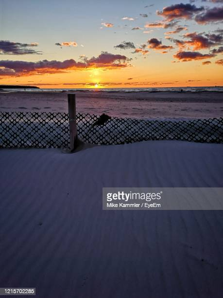 scenic view of sea against sky during sunset - rostock stock pictures, royalty-free photos & images