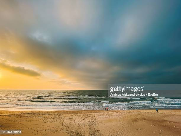 scenic view of sea against sky during sunset - lithuania stock pictures, royalty-free photos & images