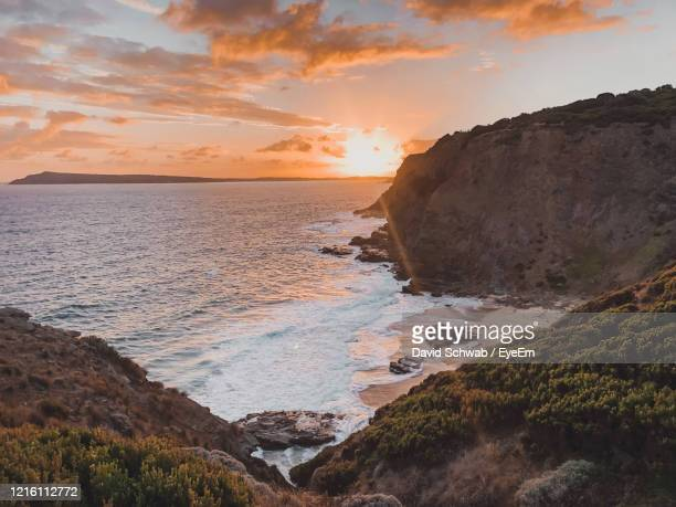 scenic view of sea against sky during sunset - david cliff stock pictures, royalty-free photos & images
