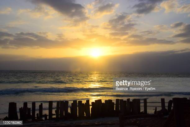 scenic view of sea against sky during sunset - beatrice stock pictures, royalty-free photos & images