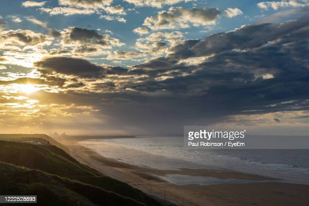 scenic view of sea against sky during sunset - saltburn stock pictures, royalty-free photos & images