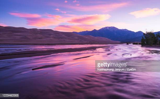 scenic view of sea against sky during sunset - colorado stock pictures, royalty-free photos & images