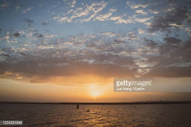 scenic view of sea against sky during sunset - wang he stock pictures, royalty-free photos & images