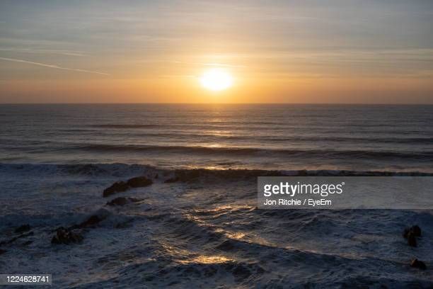 scenic view of sea against sky during sunset - sunset stock pictures, royalty-free photos & images