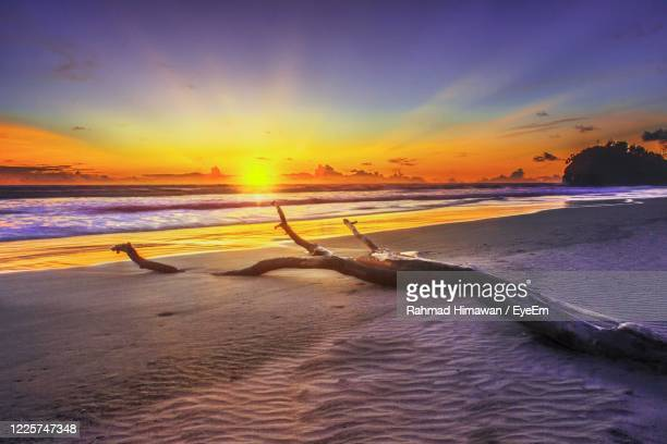 scenic view of sea against sky during sunset - rahmad himawan stock pictures, royalty-free photos & images