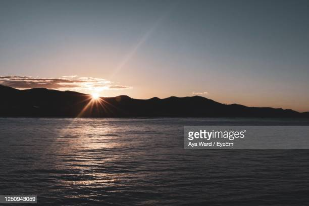scenic view of sea against sky during sunset - cayucos stock pictures, royalty-free photos & images