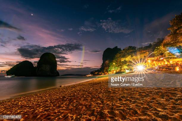 scenic view of sea against sky during sunset - noam cohen stock pictures, royalty-free photos & images