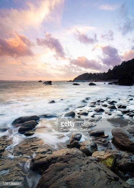 scenic view of sea against sky during sunset - torquay,_victoria stock pictures, royalty-free photos & images