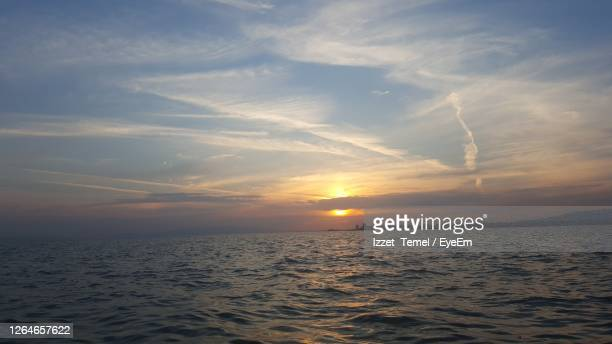 scenic view of sea against sky during sunset - image title stock pictures, royalty-free photos & images