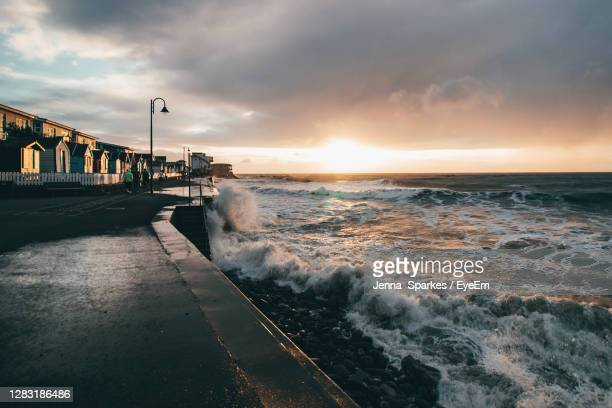 scenic view of sea against sky during sunset - dramatic sky stock pictures, royalty-free photos & images