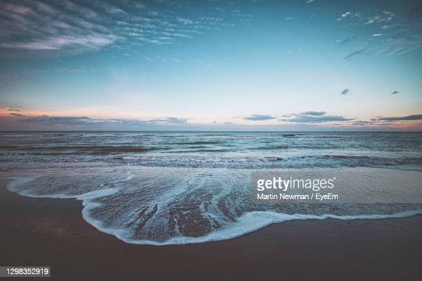 scenic view of sea against sky during sunset - dawn stock pictures, royalty-free photos & images