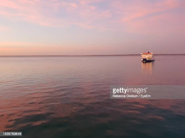 scenic view of sea against sky during sunset - portsmouth england stock pictures, royalty-free photos & images