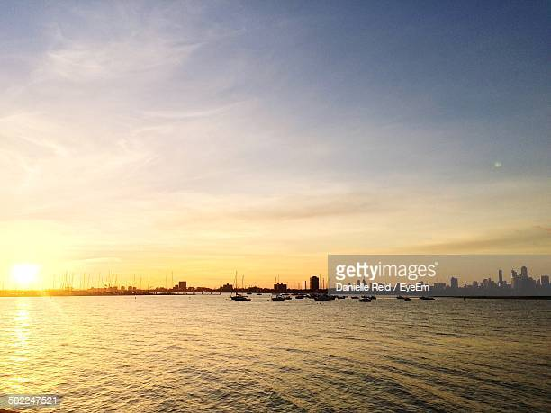 scenic view of sea against sky during sunset - reid,_wisconsin stock pictures, royalty-free photos & images