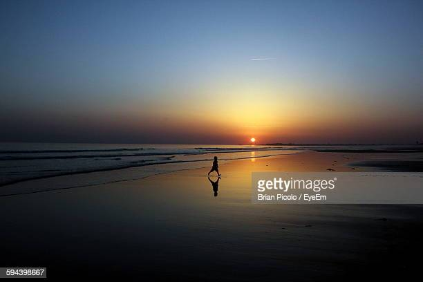 scenic view of sea against sky during sunset - unknown gender stock pictures, royalty-free photos & images