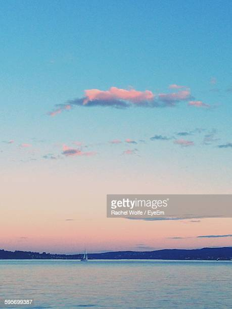 scenic view of sea against sky during sunset - rachel wolfe stock photos and pictures