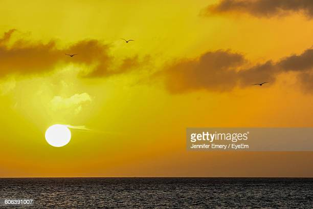 scenic view of sea against sky during sunset - emery stock photos and pictures
