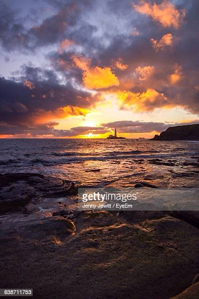 scenic view of sea against sky during sunset - whitley bay stock pictures, royalty-free photos & images