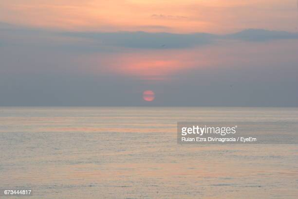 scenic view of sea against sky during sunset - negros oriental stock pictures, royalty-free photos & images