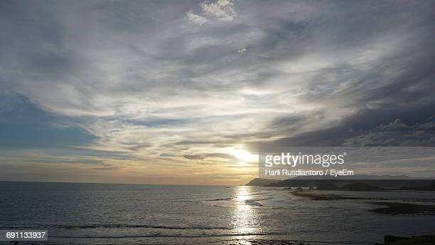 scenic view of sea against sky during sunset - harli stock pictures, royalty-free photos & images