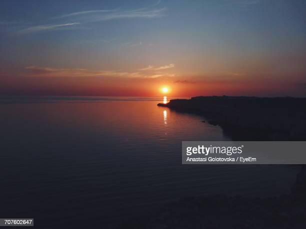 scenic view of sea against sky during sunset - anastasi foto e immagini stock