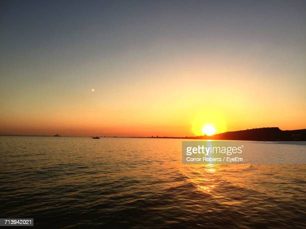 scenic view of sea against sky during sunset - conor stock pictures, royalty-free photos & images