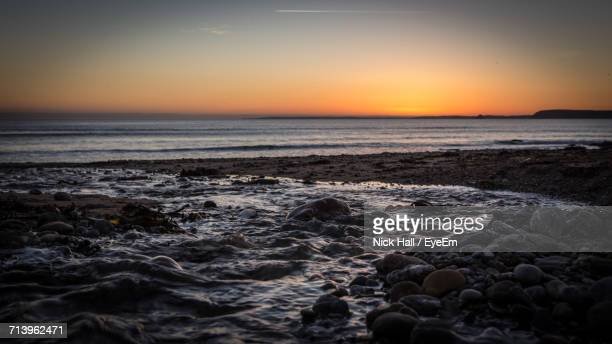 scenic view of sea against sky during sunset - mevagissey stock photos and pictures